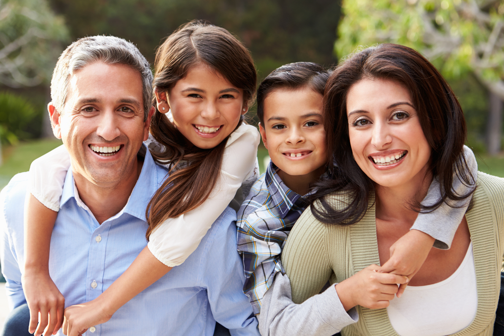 Image of a family of 4 who look for a practice like Southridge Dental who provide family dentistry services to all members and ages in one place in Surrey, BC Canada.