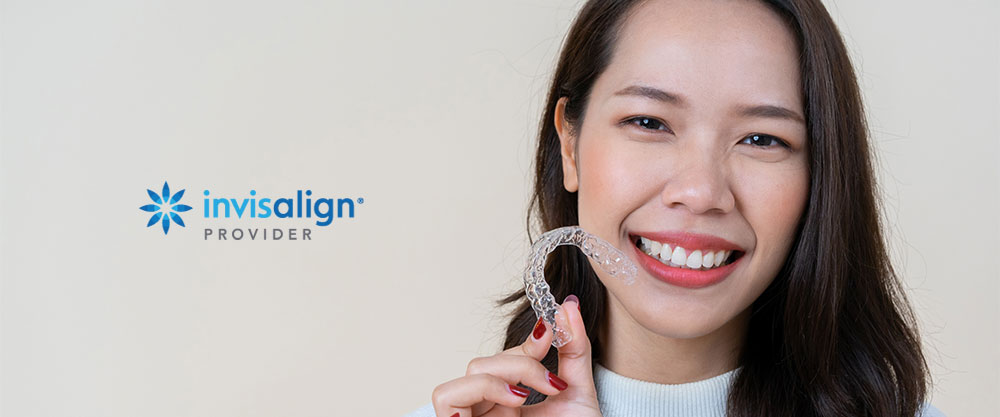 young woman with invisalign clear aligners